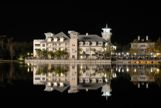 Celebration Hotel at night with reflection on water