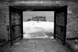 Ft Niagara sleep house looking from the Ammunitions bunker in the winter shown in b&w