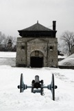 Ft Niagara weapons house with a cannon in front during the winter