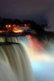 Niagara Falls at night with red lights shinning on the falls