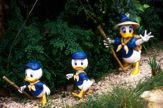 Three Duck Characters Hiking