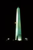 Washington Monument at night with a full moon